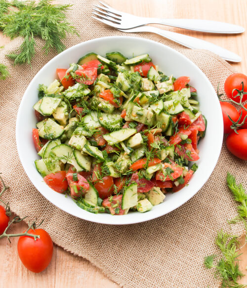 A plate of tomato cucumber avocado salad