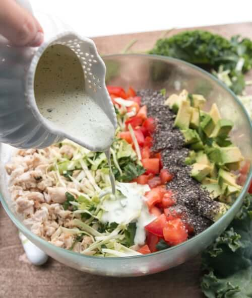 A bowl of cabbage salad with chicken and chia seeds
