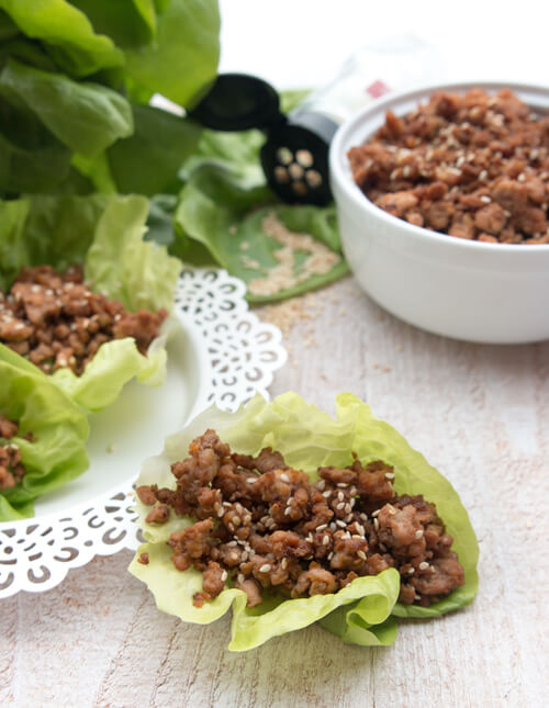 A plate of butter lettuce chicken wraps