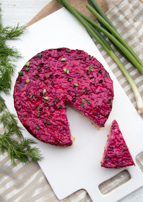 A plate of layer beet salad with herring