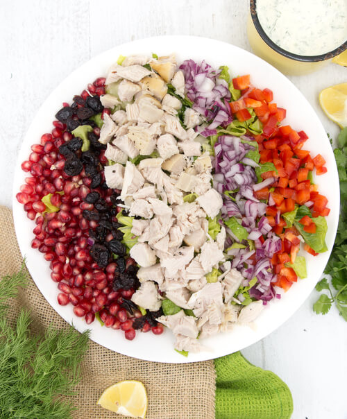 A plate of turkey salad with dairy free ranch dressing