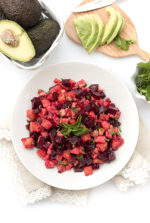 A plate of beet, avocado and pineapple salad