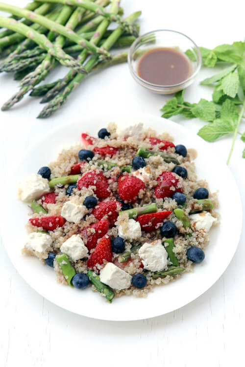 A plate of quinoa fruit salad with cheese