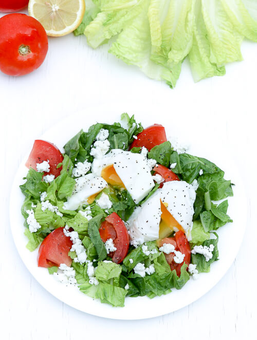 A plate of green salad with poached egg