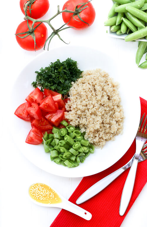 A plate of clean eating quinoa salad with lemon champagne dressing