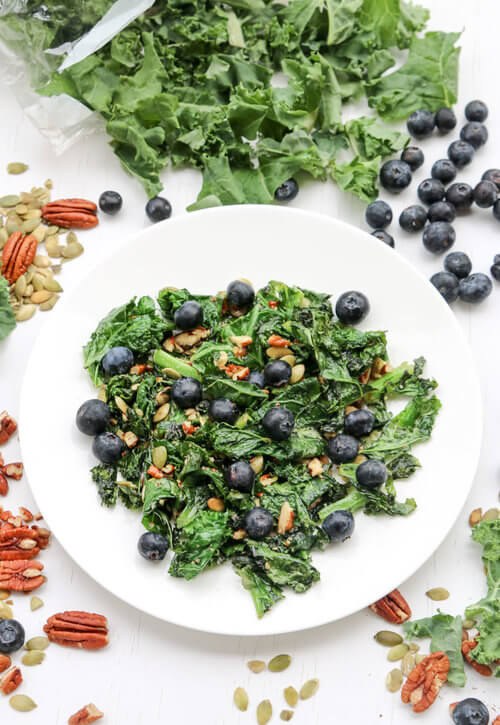 A plate crunchy kale blueberry salad recipe