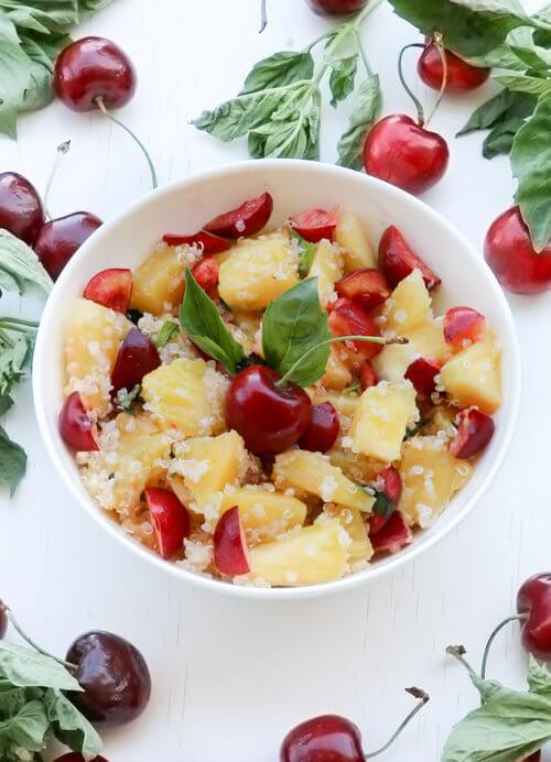 A plate of quinoa pineapple cherry salad