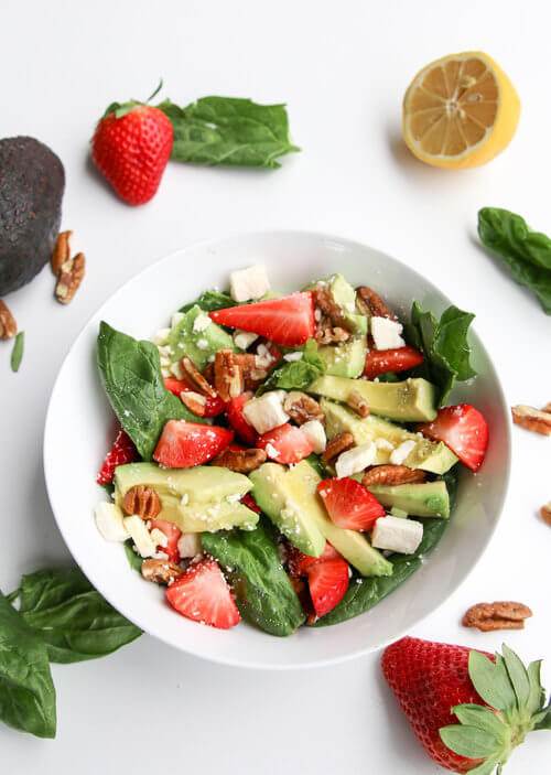 A plate of Strawberry Pecan on Spinach Salad