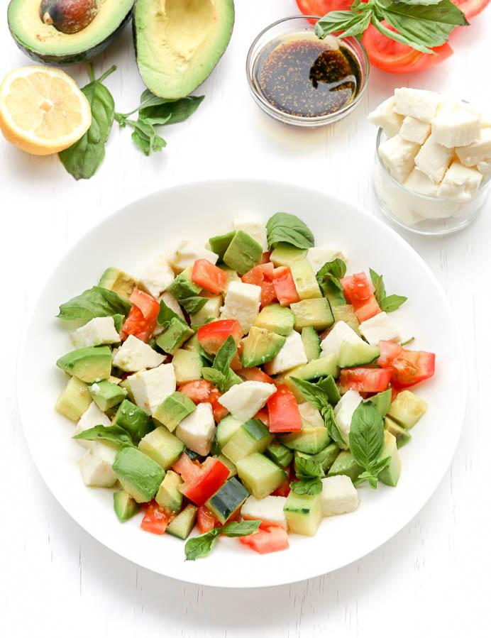 A plate of avocado caprese salad