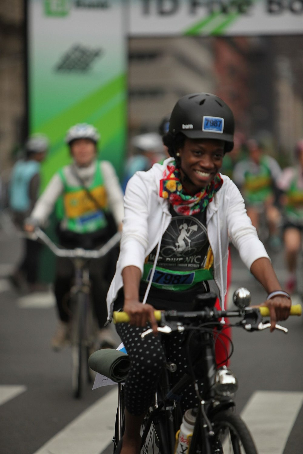 "Photo by: Bike NY. Laura rides the ""BFG"" sporting a Silk Scarf and Polka dot Leggings at her first 5 Boro Bike Tour"