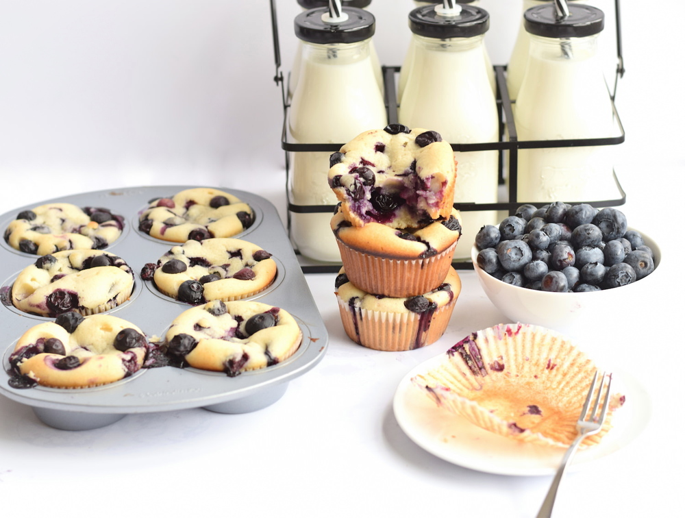 Soft and Moist Blueberry Muffins – incredibly soft and tender muffins bursting with fresh blueberries. Best blueberry muffins I've ever had! | trufflesandtrends.com