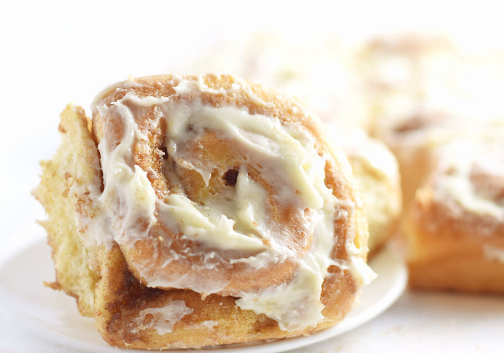 The Best Cinnamon Rolls - soft, fluffy, doughy, buttery, gooey cinnamon rolls with cream cheese frosting. Best cinnamon rolls ever! | trufflesandtrends.com
