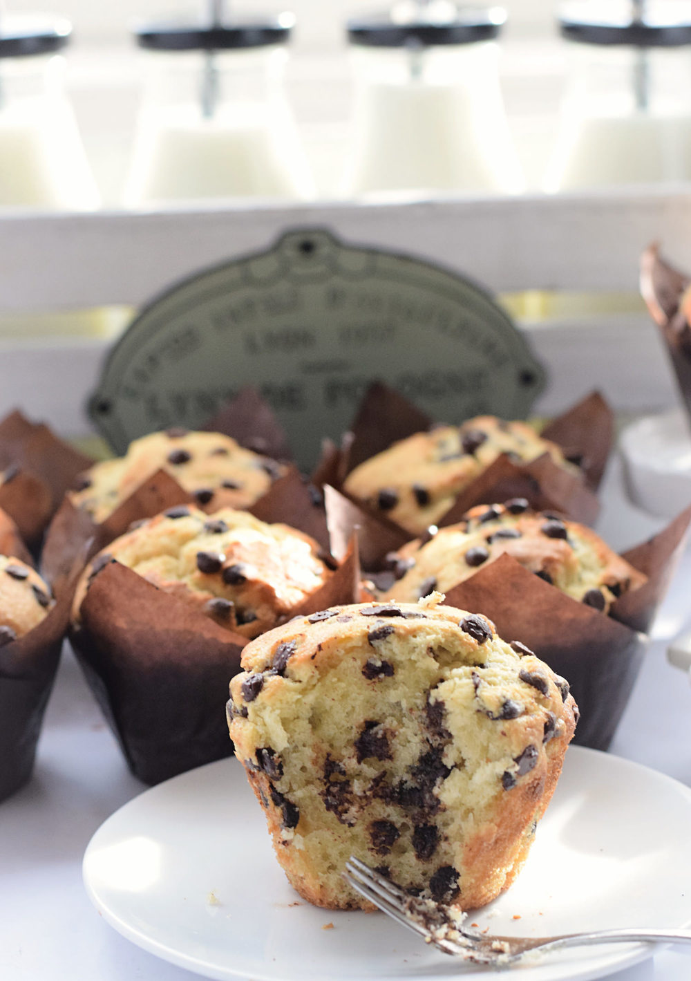 Amazing Chocolate Chip Muffins: incredibly tender, fluffy, soft muffins packed with chocolate chips. Best I've ever had! Video included! | trufflesandtrends.com
