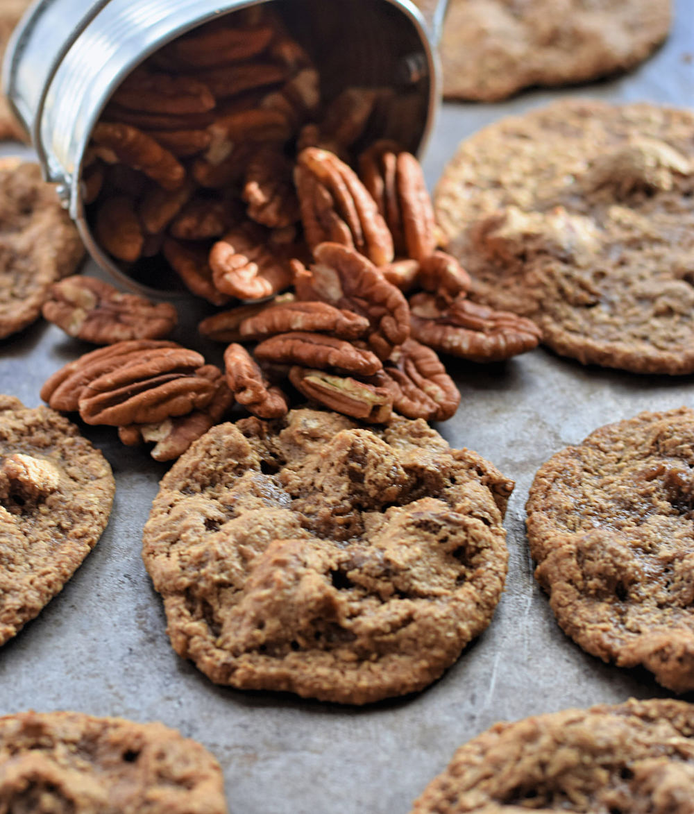 Gluten-Free Chewy Pecan Cookies: the chewiest (albeit ugliest) cookies that taste like caramel, toasted nuts, and butterscotch. Too good! | TrufflesandTrends.com