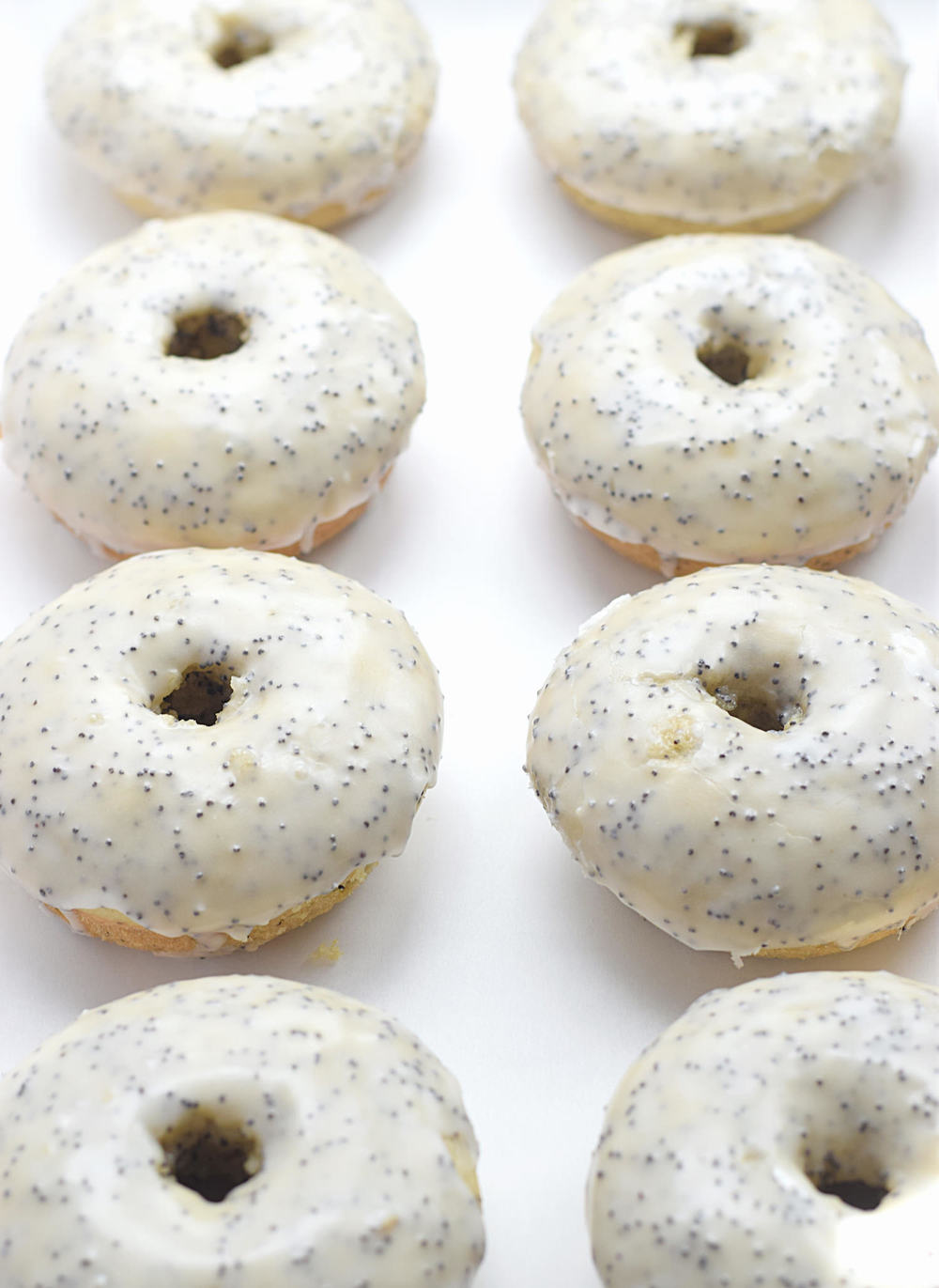 Baked Lemon Poppy Seed Donuts: soft, fluffy, super easy baked donuts full of fresh lemon flavor and studded with poppy seeds. Video included! | TrufflesandTrends.com