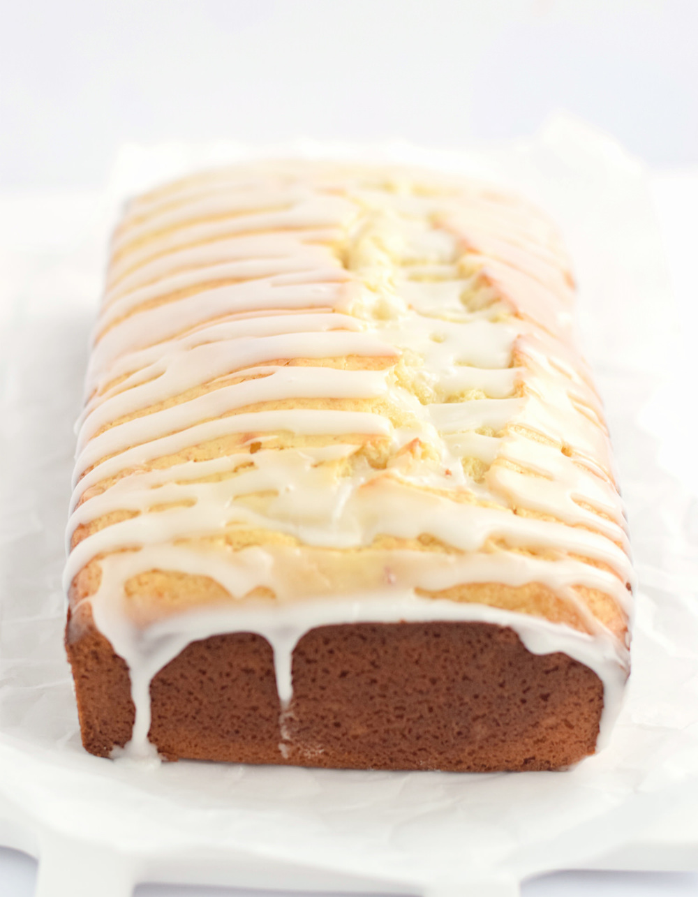 Soft and Moist Lemon Loaf: one bowl, soft, moist lemon loaf full of lemon flavor and drizzled with a tangy lemon glaze. Starbucks copycat! | TrufflesandTrends.com