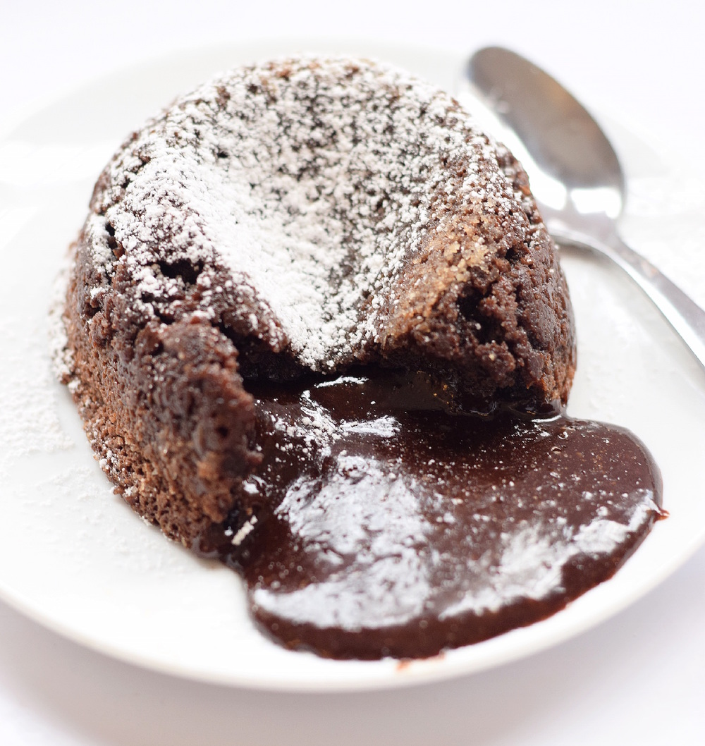 Gluten-Free Chocolate Lava Cakes: one bowl, easy, gooey, incredible chocolate lava cakes. Gluten-free with a video tutorial! TrufflesandTrends.com
