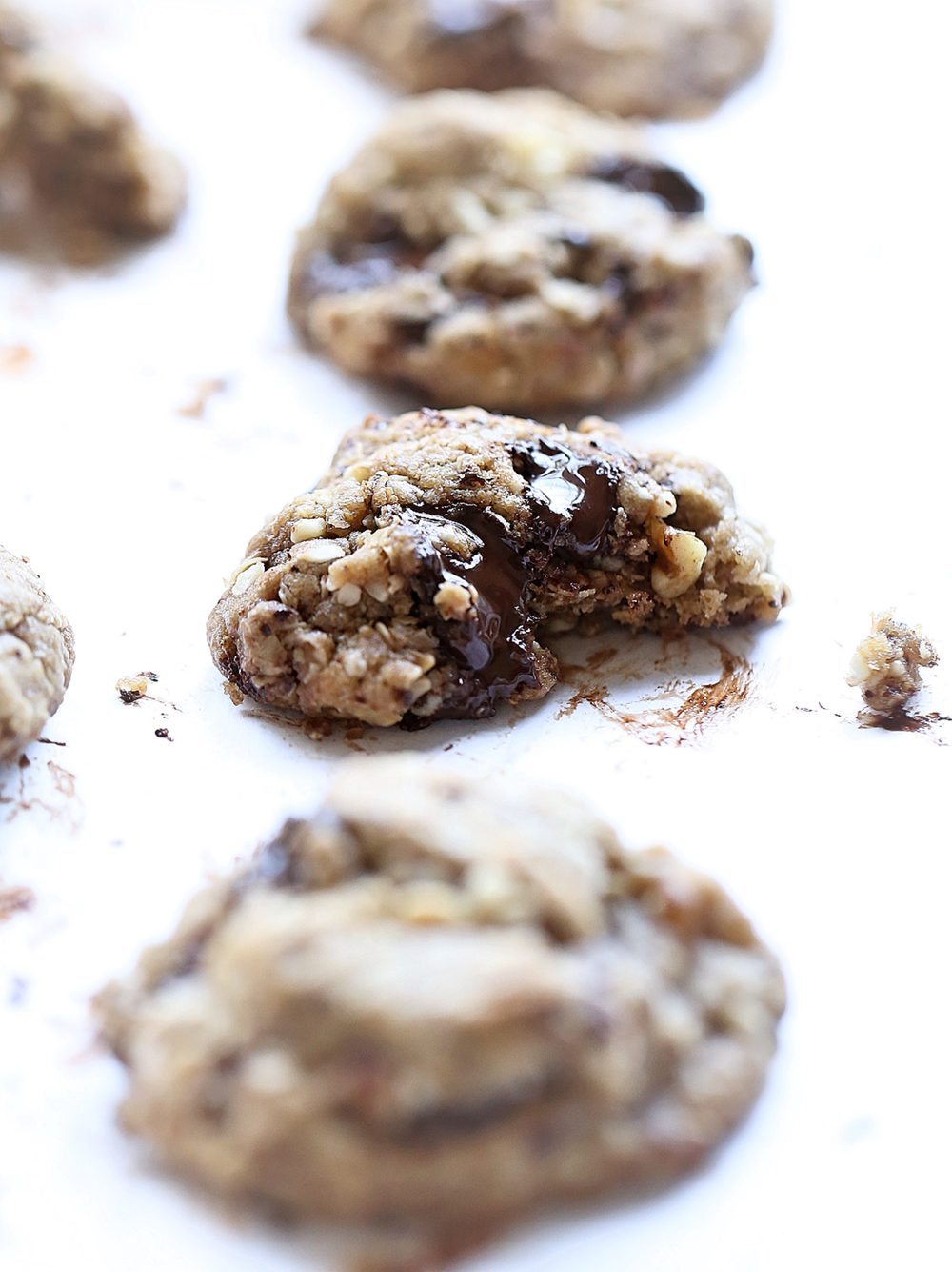 Loaded No-Butter Chocolate Chip Cookies: soft, rich, thick coconut oil cookies packed with chocolate chips, oats, coconut, and nuts. So easy and good! | TrufflesandTrends.com