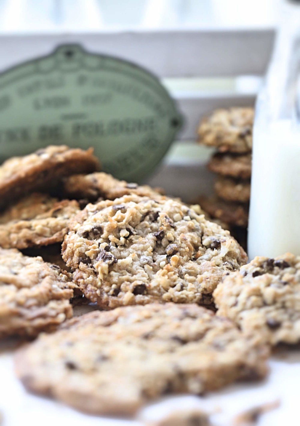 Thin and Chewy Everything Cookies: super chewy coconut oil cookies packed with chocolate chips, oats, nuts, and coconut. Greasy and addictive! | TrufflesandTrends.com