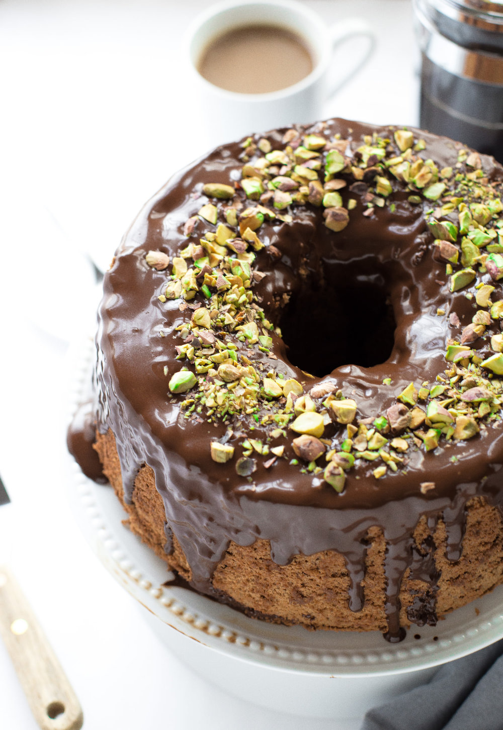 Chocolate Chiffon Cake with Ganache Glaze: fluffy, airy, light chocolate cake topped with a rich, creamy, chocolate ganache. | TrufflesandTrends.com