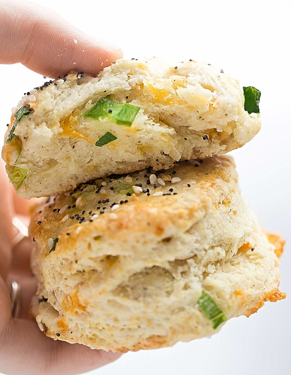 Green Onion Cheddar Scones: amazing, tender, buttery scones filled with green onions, cheddar cheese, and a sprinkling of black pepper. | TrufflesandTrends.com