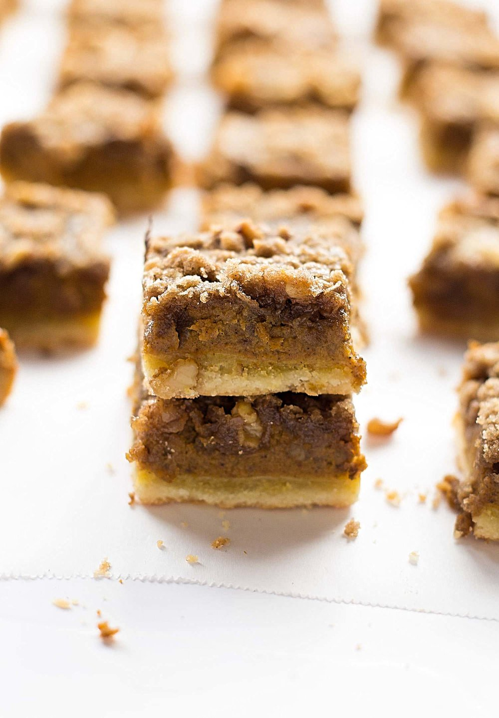 Pumpkin Pie Streusel Bars: buttery shortbread crust, creamy pumpkin filling, and a cinnamon streusel on top. Thanksgiving dessert perfection! | TrufflesandTrends.com
