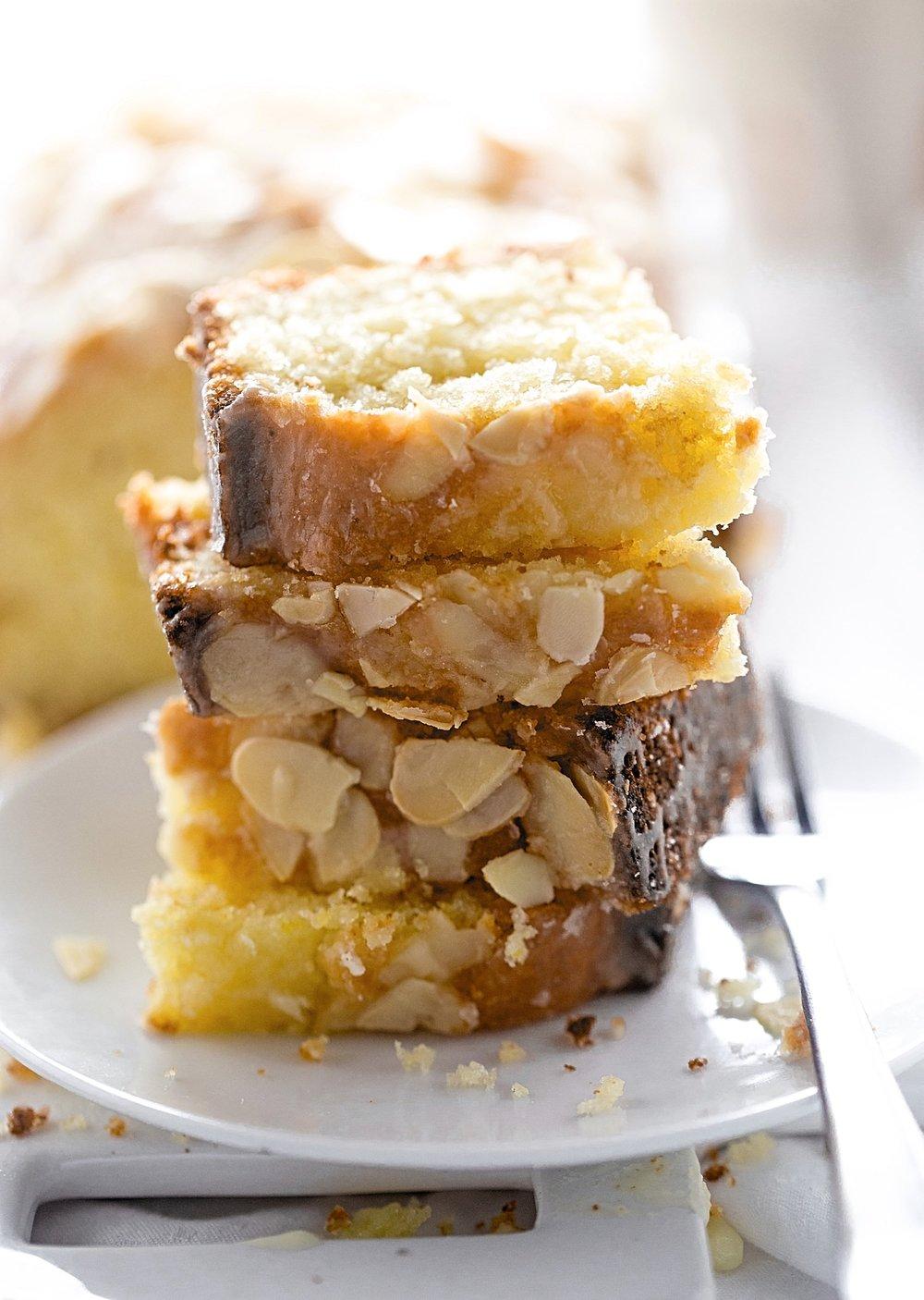 Moist Orange Almond Loaf Cake: super easy, soft, moist orange cake with a hint of almond flavor and a sweet orange glaze. | TrufflesandTrends.com