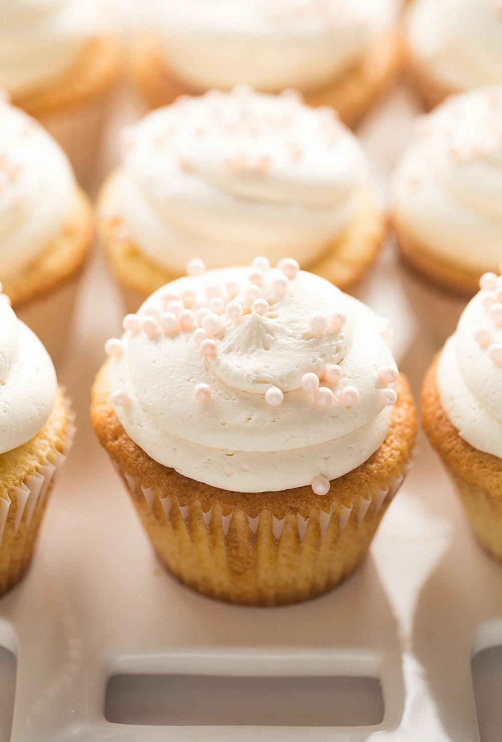 Fluffiest Vanilla Cupcakes with Buttercream Frosting: the softest, fluffiest, tastiest vanilla cupcakes with a classic vanilla buttercream. | TrufflesandTrends.com
