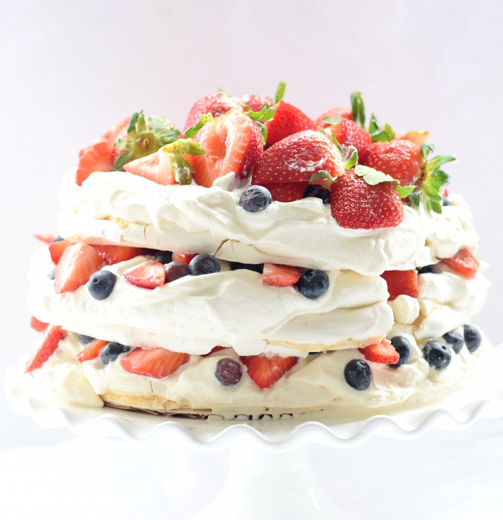 Mixed Berry Pavlova Layer Cake | TrufflesandTrends.com