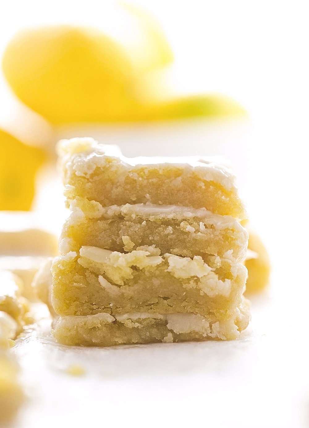 No-Butter Glazed Lemon Blondies: soft, gooey, rich lemon blondies, or lemonies. Made with coconut oil and a tangy lemon glaze. So easy!