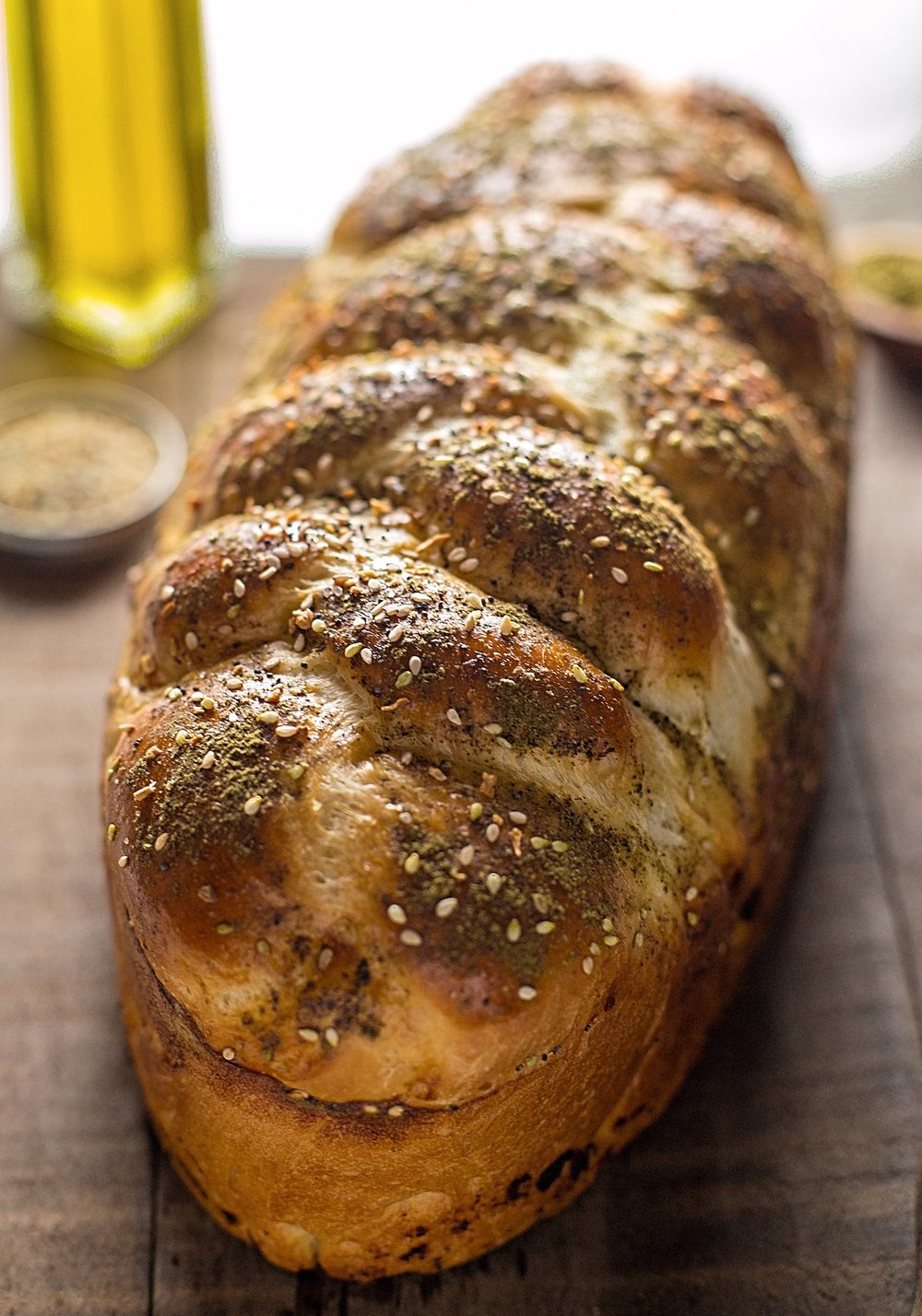 Egg-Free Garlic Crusted Challah: soft, doughy, glossy, egg-free challah bread made with a delicious olive oil-garlic crust. | TrufflesandTrends.com
