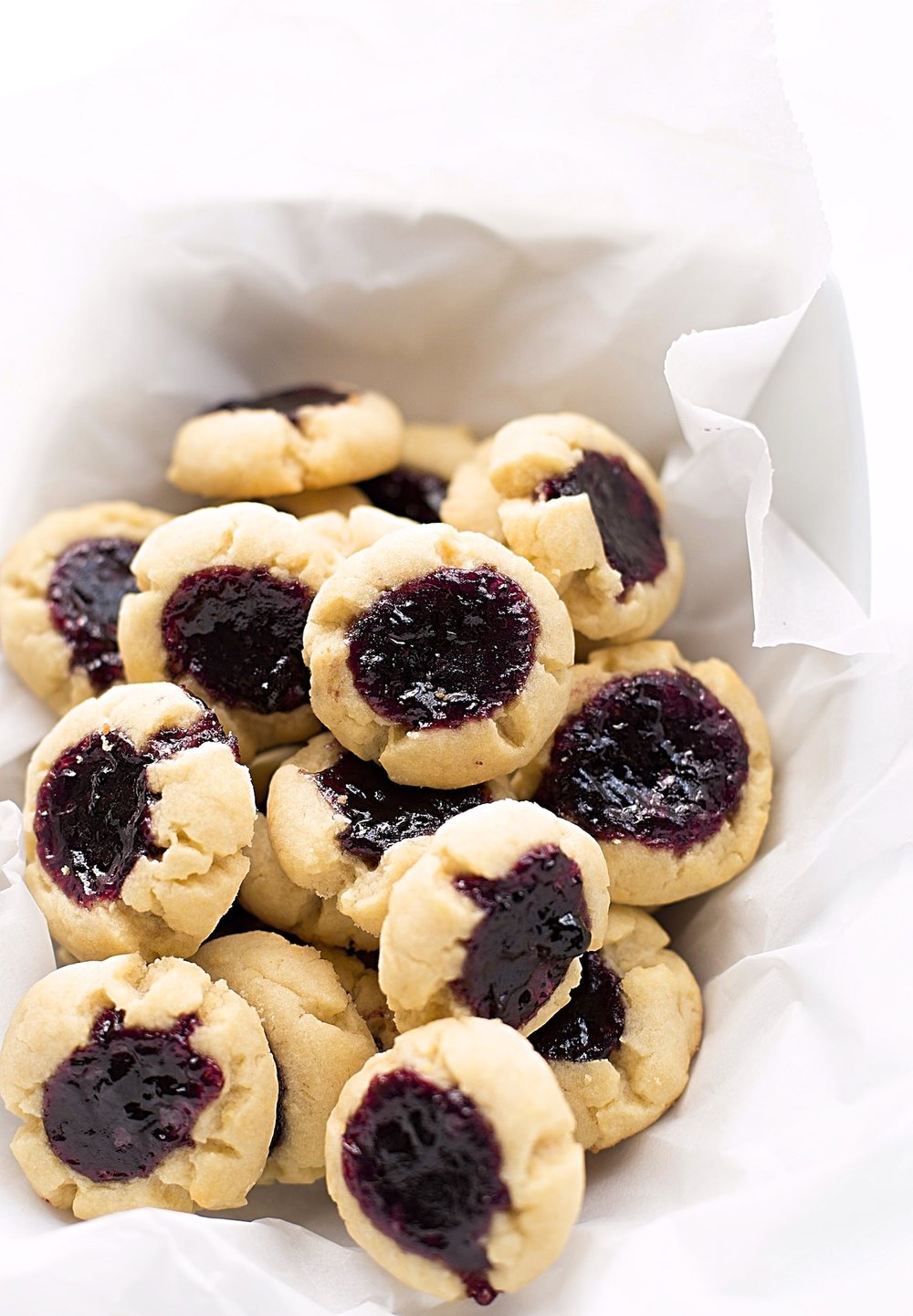 Tender Jam Thumbprint Cookies: melt-in-your-mouth, crumbly, tender, easy, dairy-free jam thumbprint cookies. Video included! | TrufflesandTrends.com
