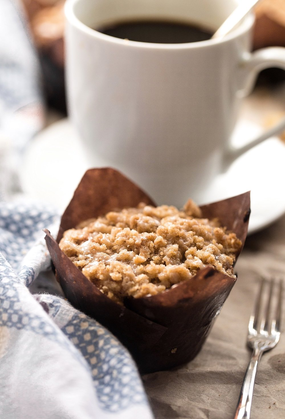 Honey Glazed Apple Crumb Muffins: soft, fluffy, moist muffins packed with apples and topped with a tasty crumble and honey glaze. Video Included! | TrufflesandTrends.com