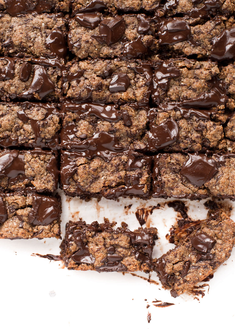 Whole Wheat Almond Butter Chocolate Chip Bars: 100% whole wheat, healthy, soft, super chewy, rich, chocolate packed, addictive almond butter bars. | TrufflesandTrends.com