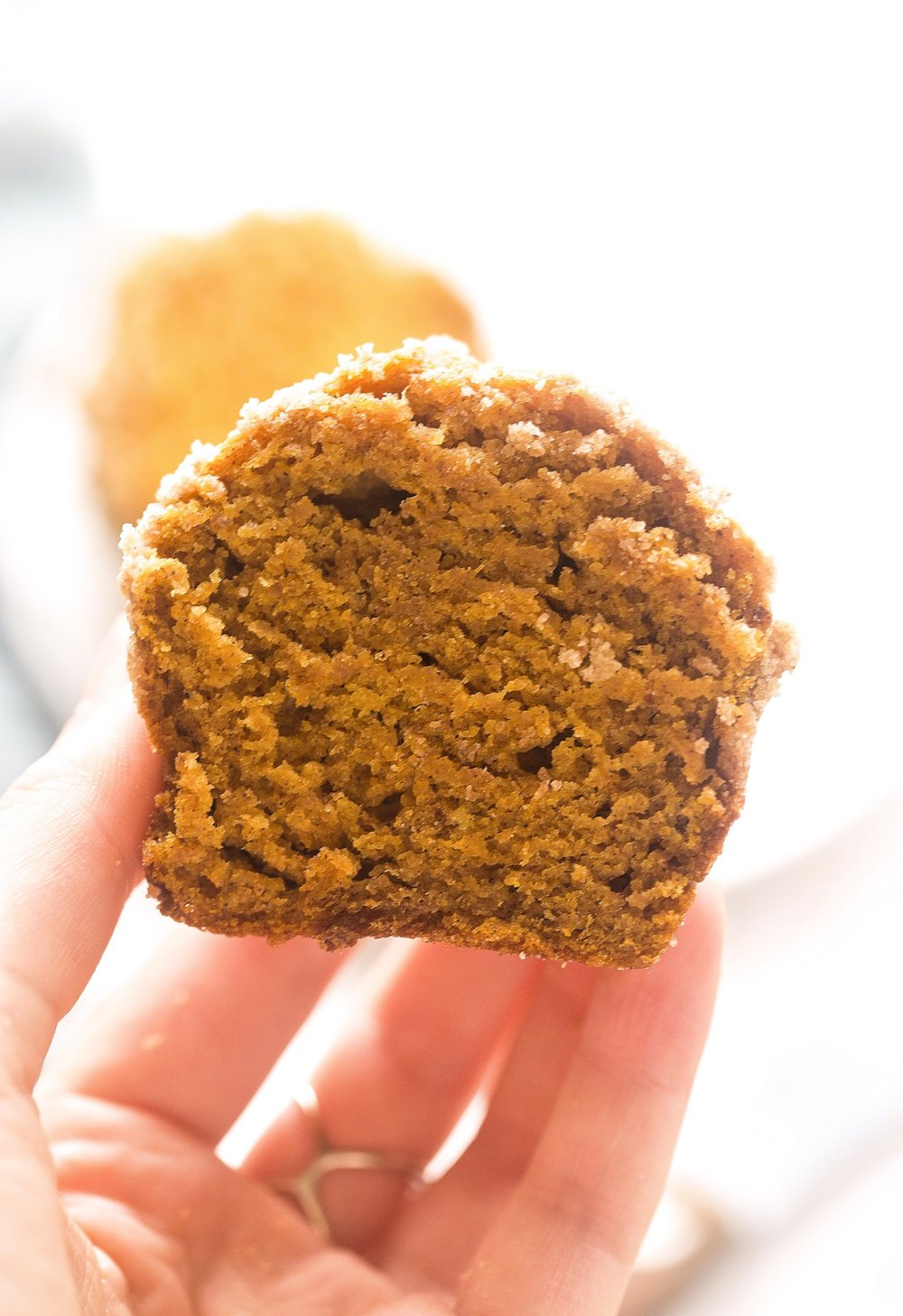 Pumpkin Crumb Muffins: soft, moist, pumpkin muffins filled with warm fall spices and topped with a generous crumble. | TrufflesandTrends.com