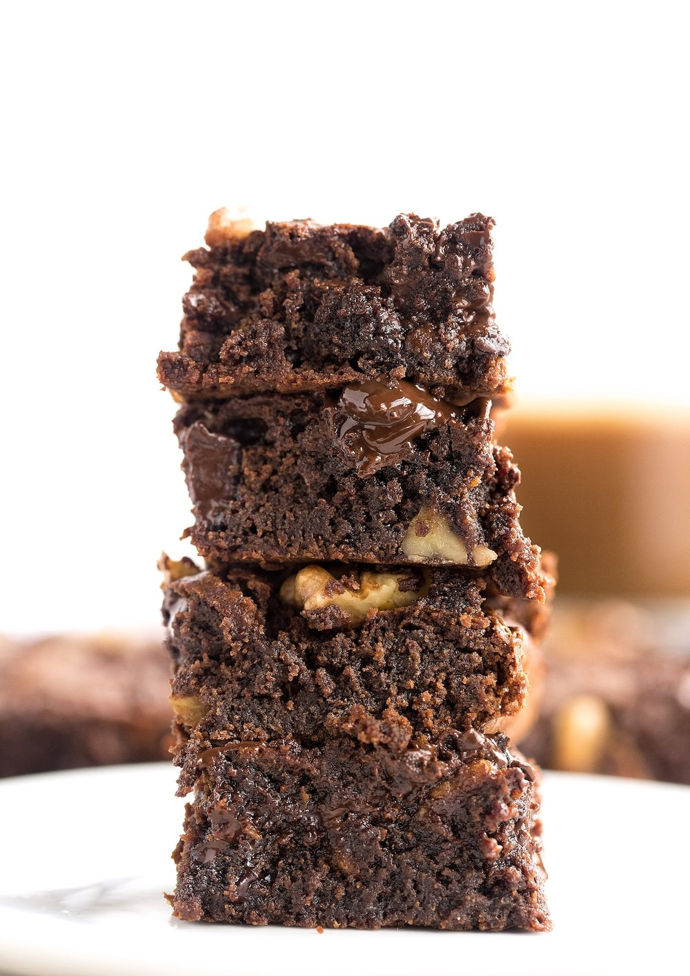 Wholesome Flourless Tahini Brownies: easy, quick, rich, gooey brownies made without dairy, refined sugar, oil, or gluten. Too good! | TrufflesandTrends.com