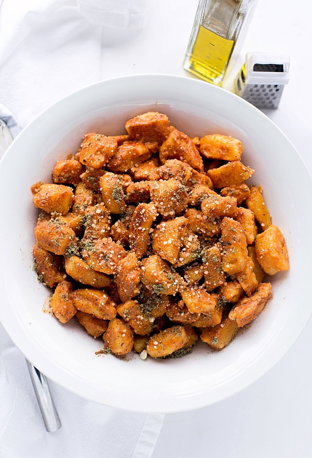 Sweet Potato Gnocchi with Tomato Cream Sauce: soft, pillowy, toasted sweet potato gnocchi in an easy tomato cream sauce. Best dinner! | TrufflesandTrends.com
