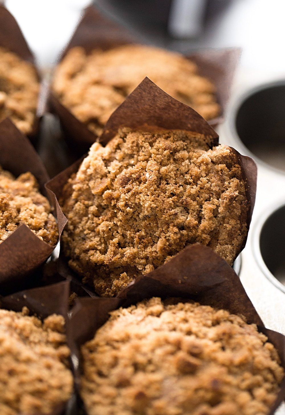 Whole Wheat Pecan Crumb Muffins: soft, moist, fluffy, easy, 100% whole-wheat muffins filled with toasted pecan bits and topped with a tasty crumble. | TrufflesandTrends.com