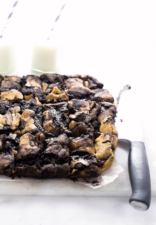 Gooey Chocolate Swirled Cookie Bars: soft, rich, cookie dough-like cookie bars with a gooey chocolate mixture swirled through. So easy! | TrufflesandTrends.com