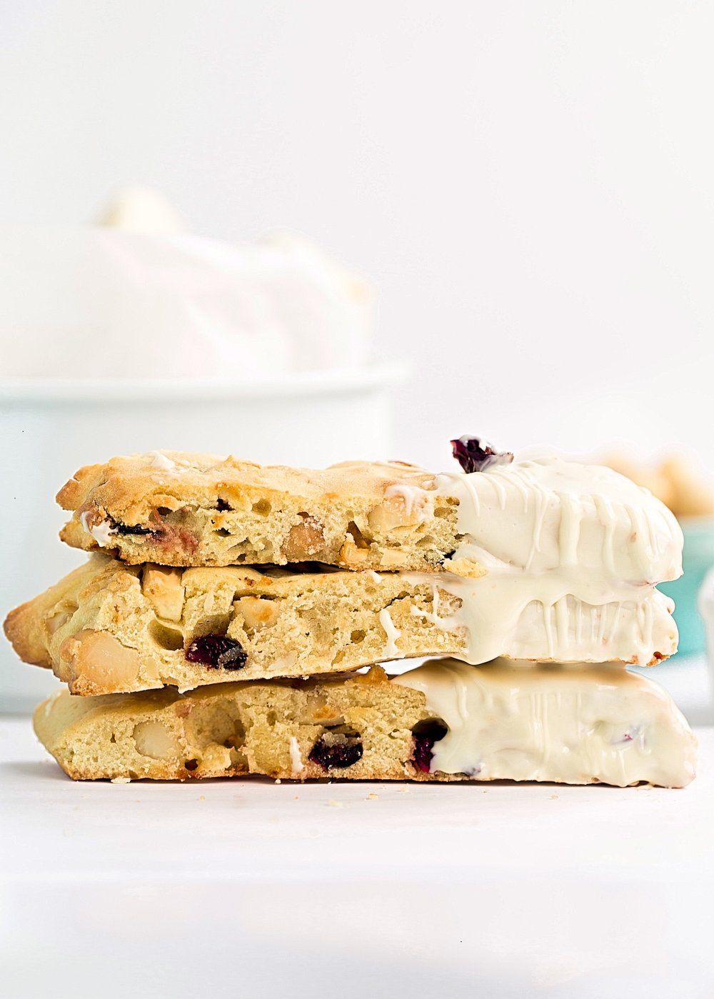 White Chocolate Cranberry Macadamia Biscotti: easy, tender biscotti full of white milk chocolate, dried cranberries, and macadamias. Video Included! | TrufflesandTrends.com