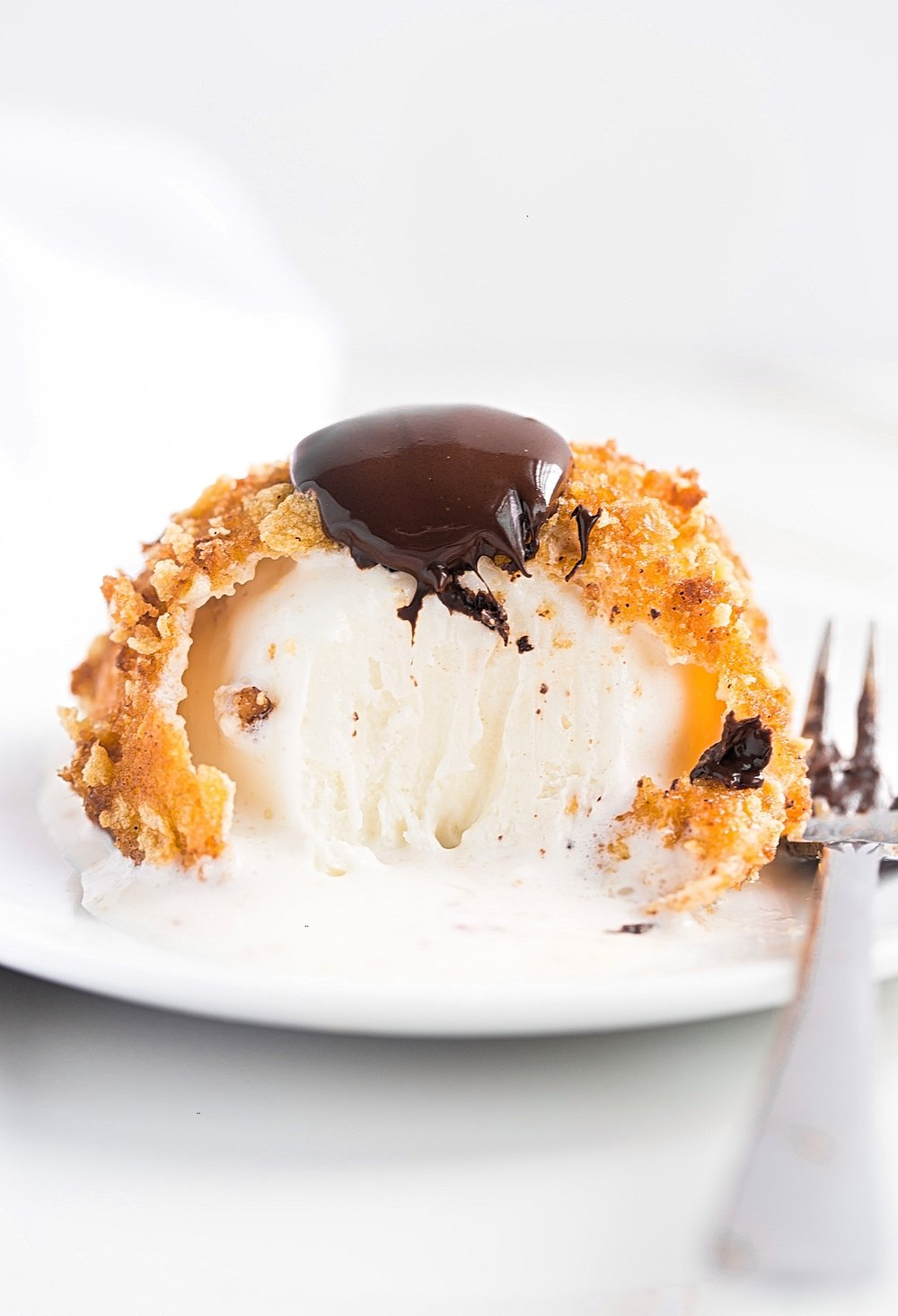 Deep Fried Ice Cream: vanilla ice cream coated in a sweet, crunchy cookie topping, deep-fried for the ultimate hot and cold dessert! | TrufflesandTrends.com