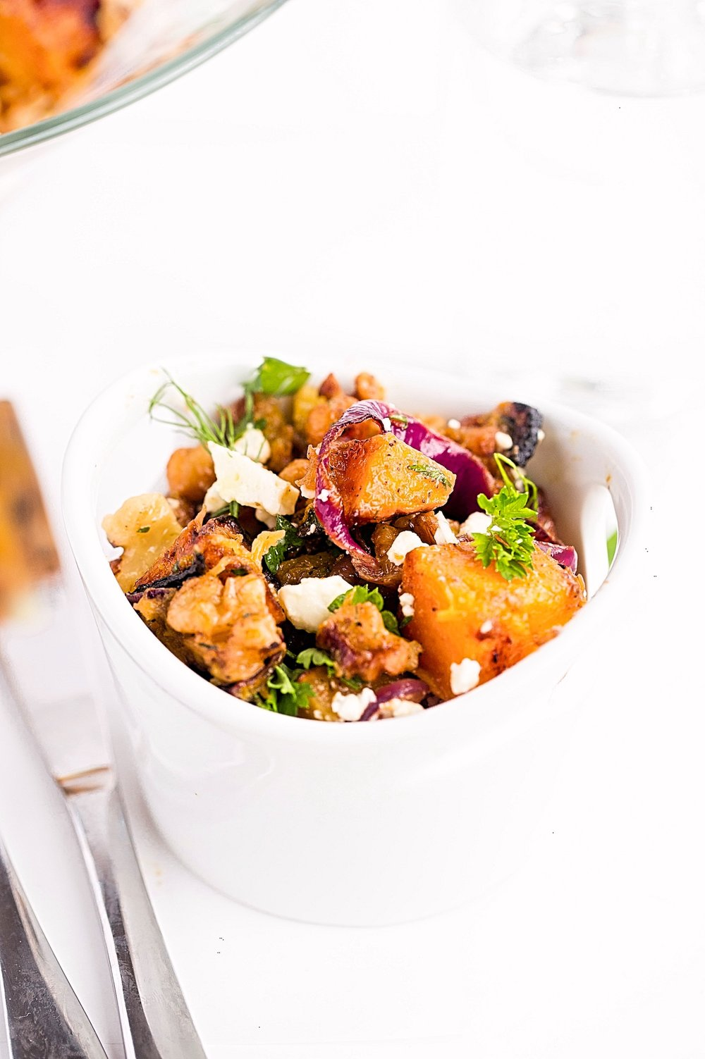 Herby Roasted Squash Red Onion Chickpea Salad: you'll want to make this wholesome, cozy butternut squash salad tossed in an herb-filled, tasty dressing all winter long. | TrufflesandTrends.com