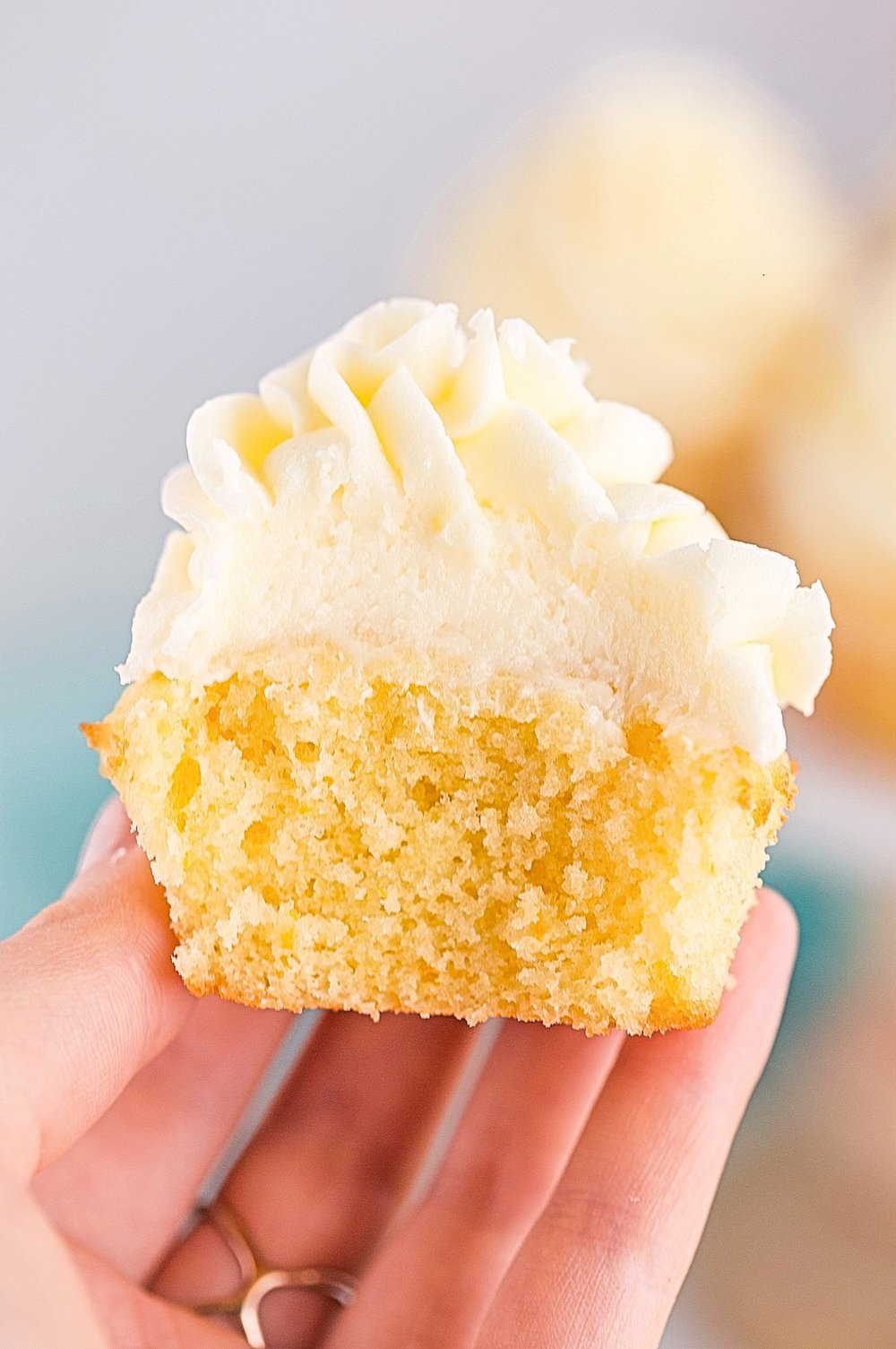 Orange Creamsicle Cupcakes: soft, super-fluffy cupcakes full of orange flavor and topped with a sweet orange buttercream frosting. | TrufflesandTrends.com