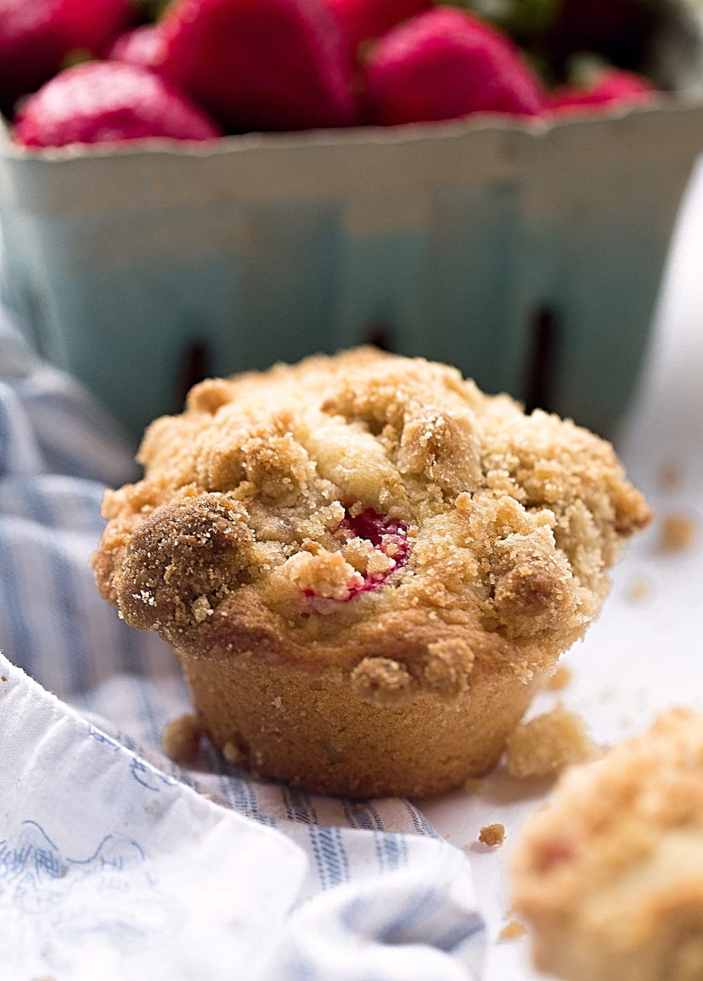 Fluffy Strawberry Crumb Muffins: light, soft, moist muffins filled with fresh strawberries and topped with a tasty crumble. Valentine's Day perfection. | TrufflesandTrends.com