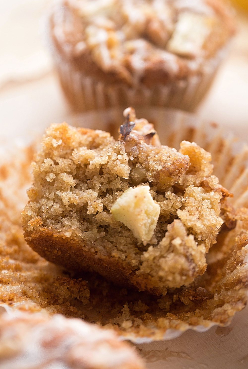 Gluten-Free Apple Cinnamon Muffins: light, moist, almost gooey gf muffins, filled with tart apples, crunchy walnuts, and spicy cinnamon. So good! | TrufflesandTrends.com
