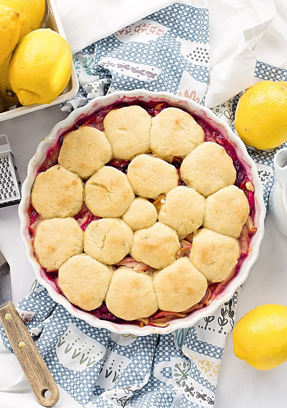 Lemon Cookie Summer Fruit Cobbler: sweet summer fruits topped with soft, gooey, citrusy lemon cookies. Summer in a dish! | TrufflesandTrends.com