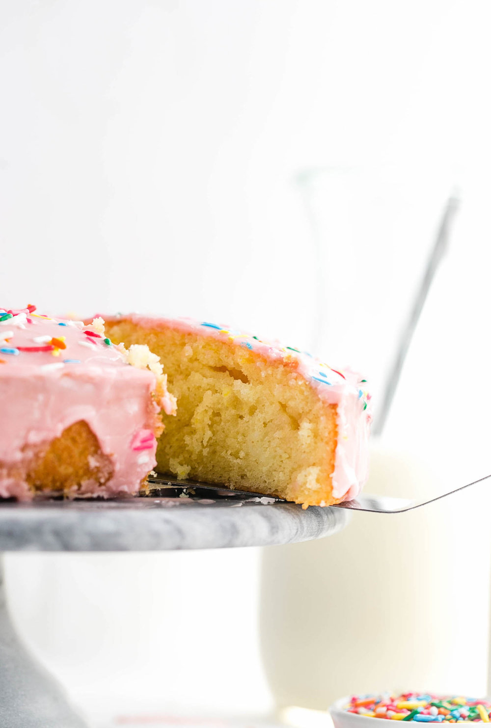 Basic Glazed Vanilla Cake: soft, fluffy, moist, dairy-free vanilla round cake with a classic vanilla glaze. Quick and easy! | TrufflesandTrends.com
