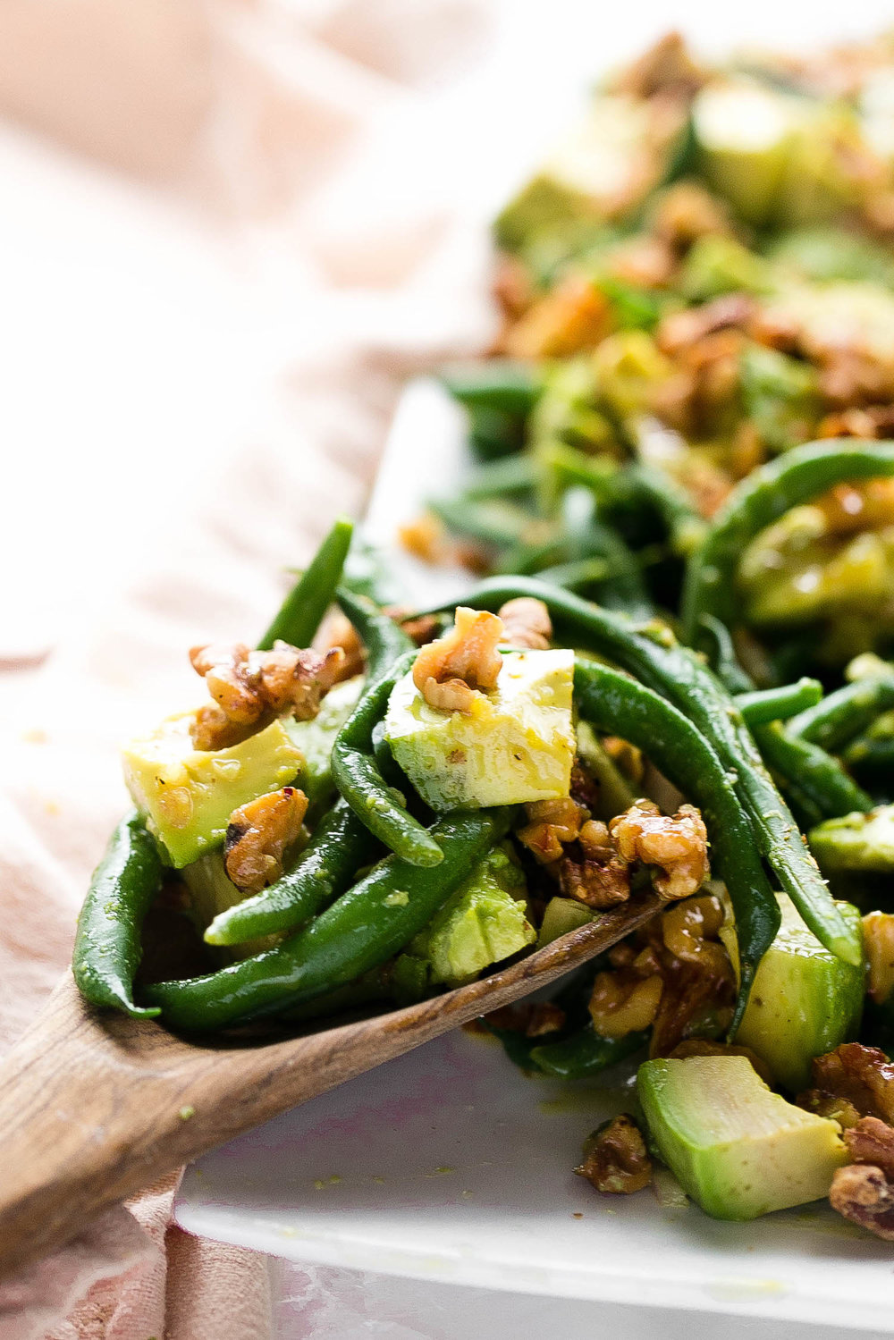 Honey Dijon Avocado Green Beans: crisp green beans with cubed avocado and toasted walnuts, tossed in a honey Dijon dressing. | TrufflesandTrends.com