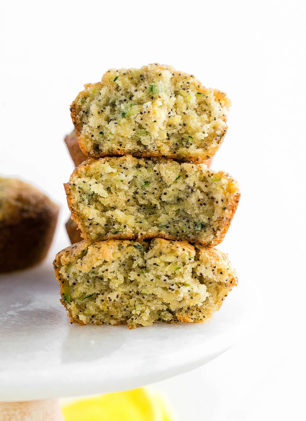 Zucchini Lemon Poppy Seed Muffins: dairy-free, super soft and moist muffins filled with zucchini, zesty lemon flavor, and crunchy poppy seeds. | TrufflesandTrends.com