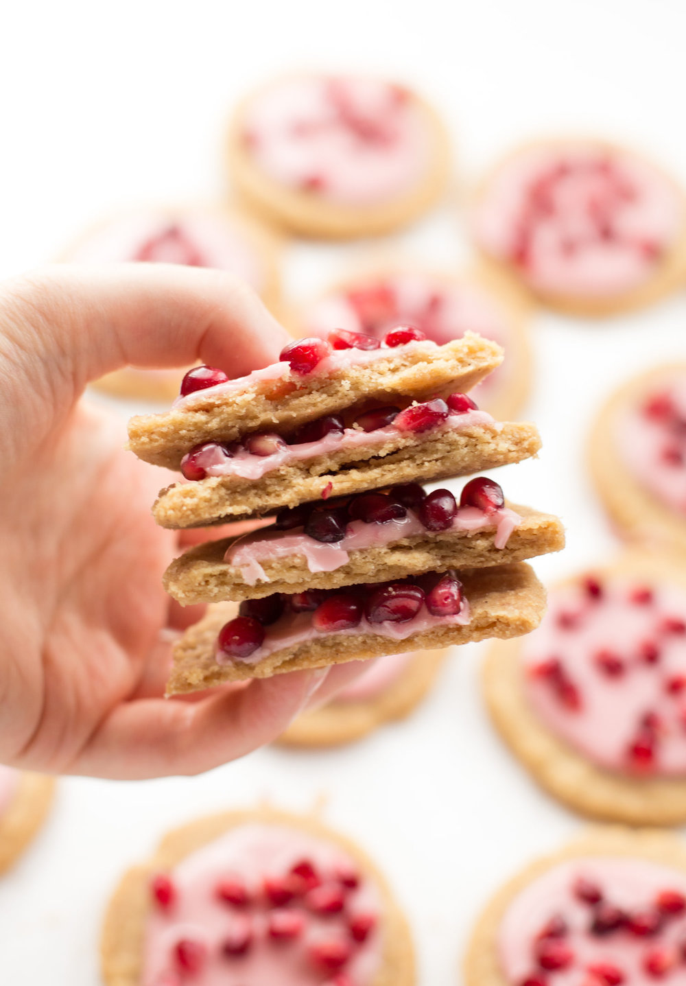 Brown Sugar Shortbread Cookies with Pomegranates: tender, melt-in-your-mouth, six-ingredient shortbread cookies topped with a two-ingredient, naturally colored glaze and pomegranate seeds. | TrufflesandTrends.com